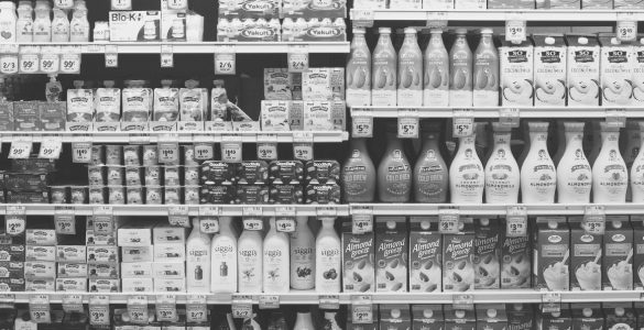 almond milk products on supermarket shelves