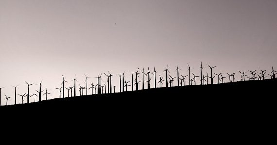 wind farm on a hill for sustainable energy
