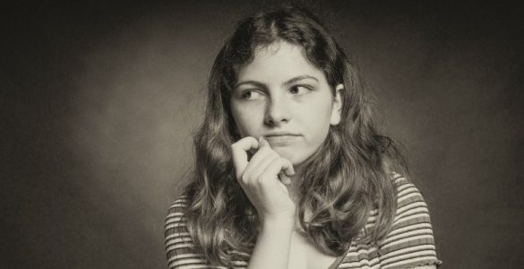 young woman deep in thought