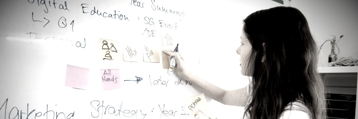 womn with ideas on a whiteboard