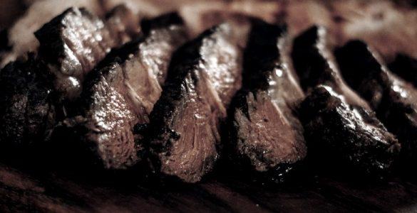 seared steak sliced on a platter
