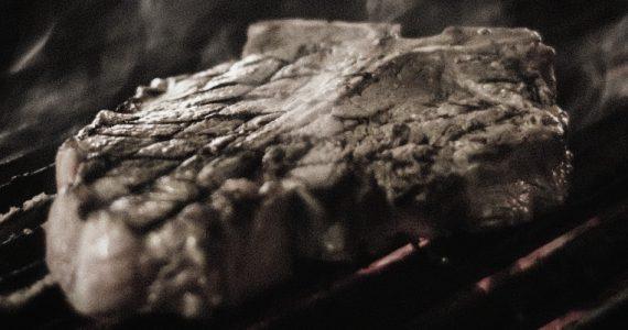 seared steak on a barbecue